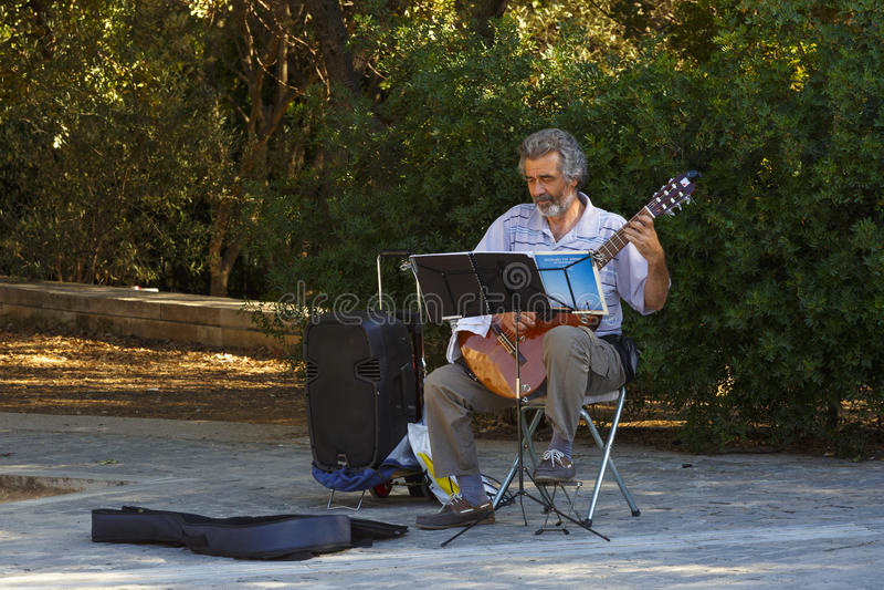 Músico em Atenas, Grécia imagem de stock royalty free
