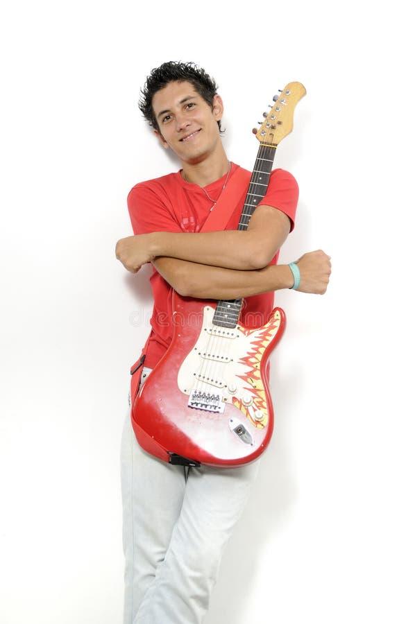 Músico novo com gitar elétrico imagem de stock