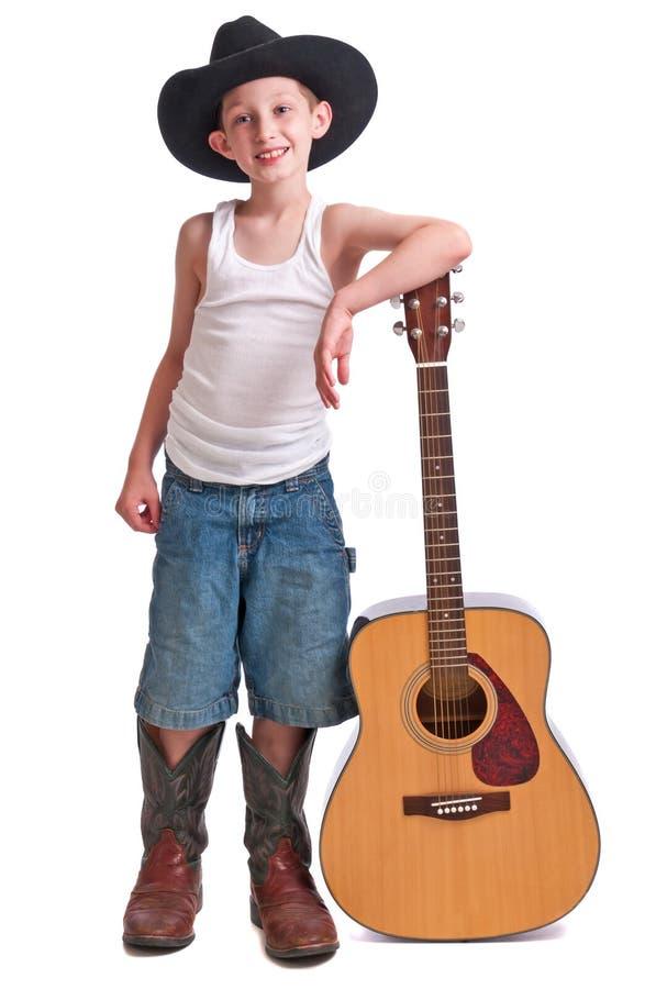 Músico pequeno do cowboy fotos de stock royalty free