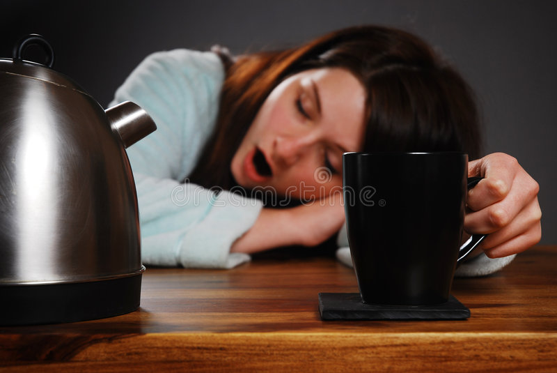 Müde Frau stockbilder