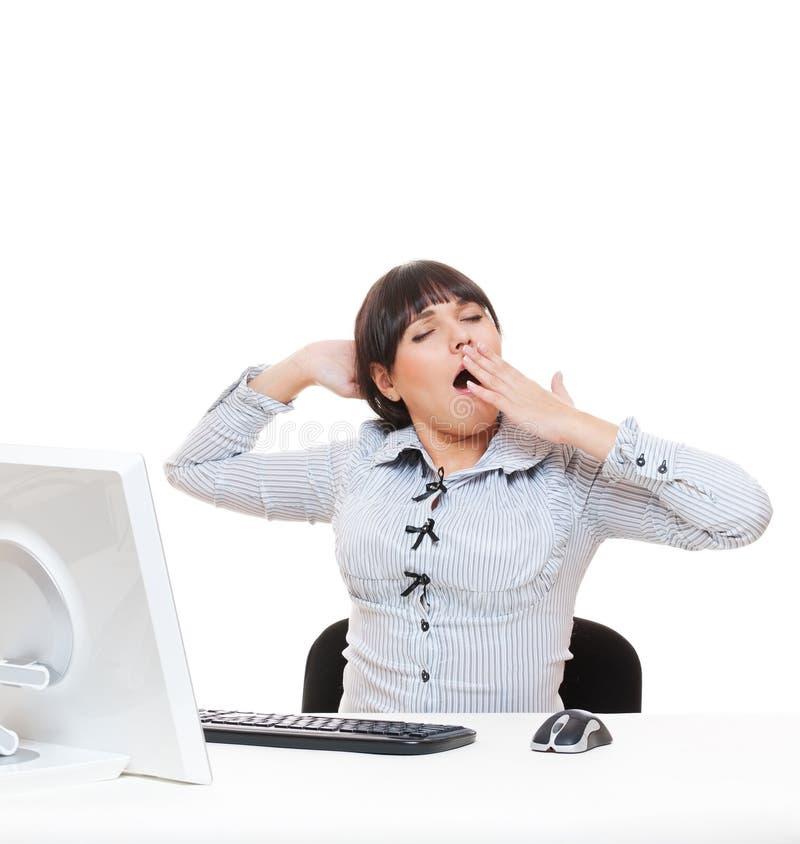 Müde gähnende Geschäftsfrau lizenzfreie stockbilder