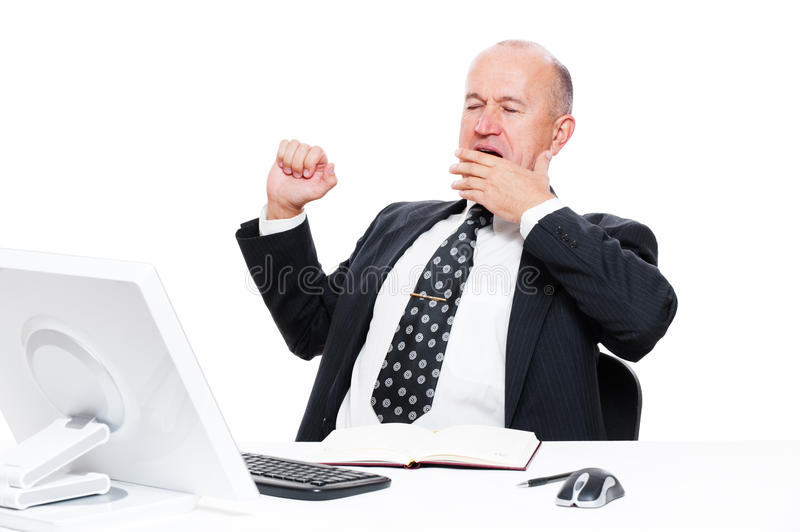 Müder Geschäftsmann im Büro stockbilder