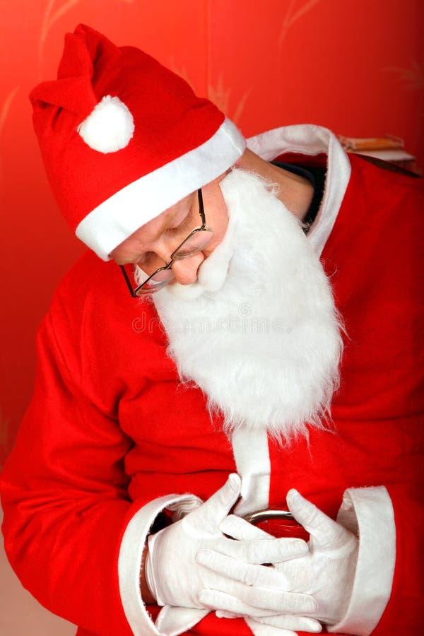 Müder Weihnachtsmann lizenzfreie stockbilder