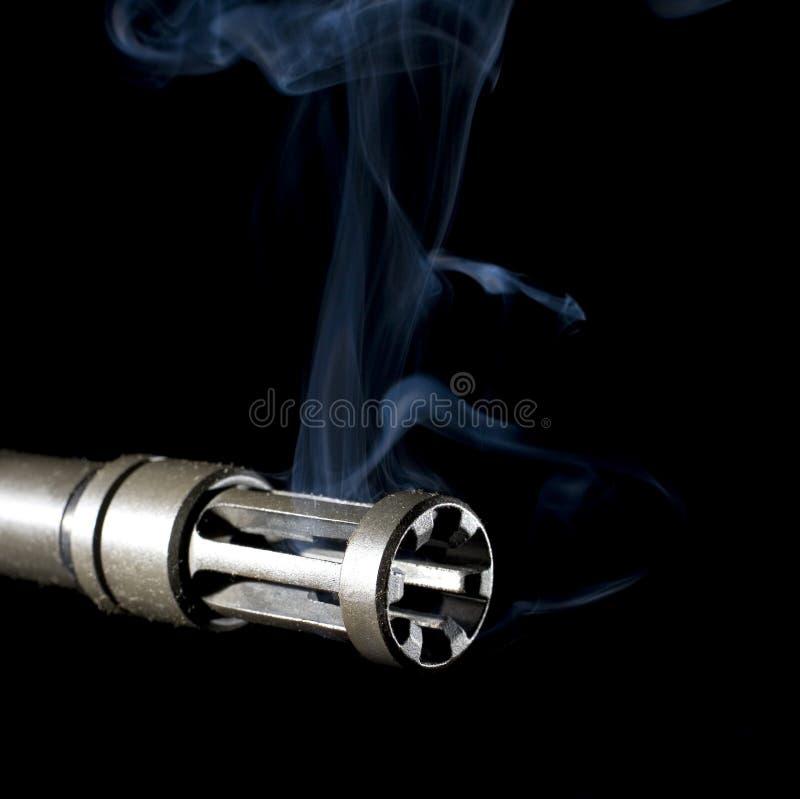 Mündungsbremse und -rauch stockbild