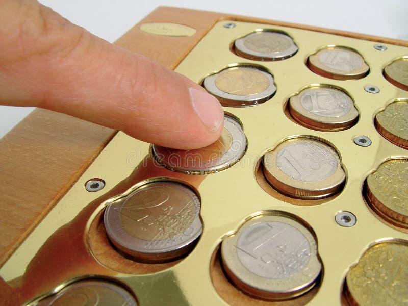 Münze holden 3 lizenzfreie stockbilder
