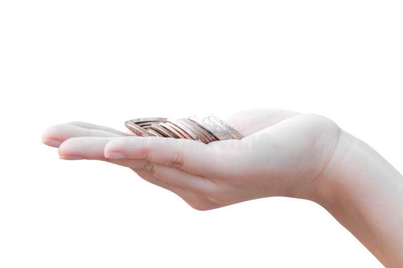 Münzen in den Händen lokalisiert auf Weiß stockfotos