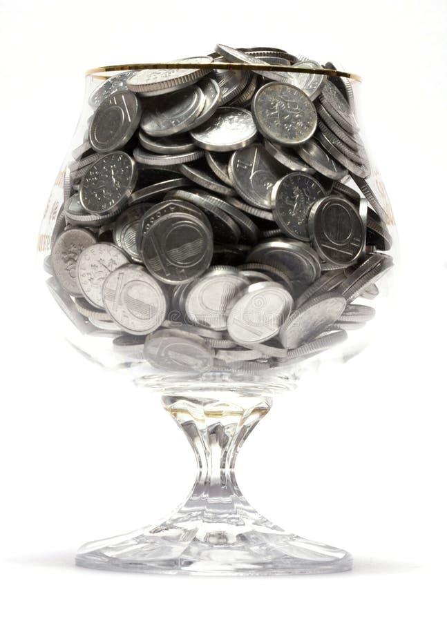 Münzen-Geld in einem Glas stockfoto