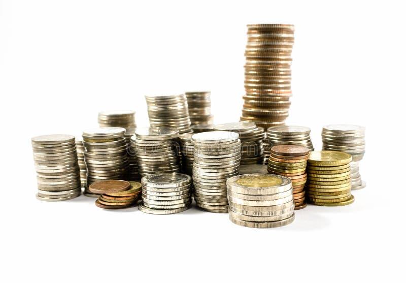 Münzen getrennt auf Weiß stockfotografie