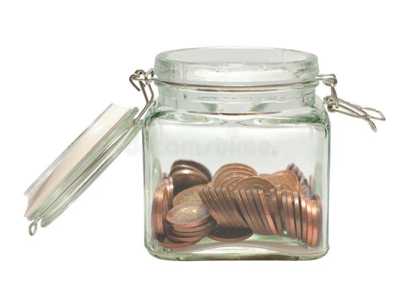 Münzen im Glas lizenzfreie stockfotos