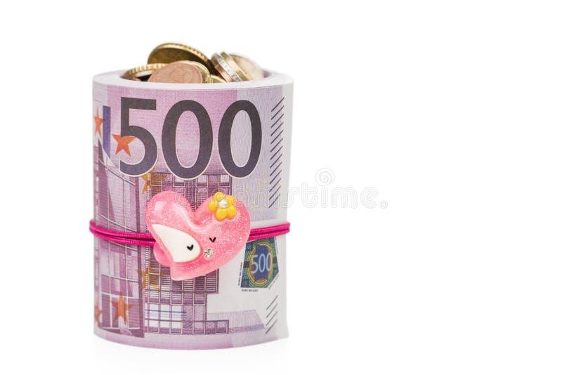 Münzen im Papiergeld als Geschenk stockfoto