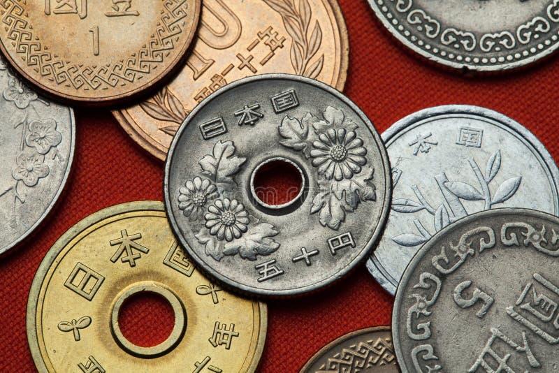 Münzen von Japan abstrakter Farbenhintergrund stockbild