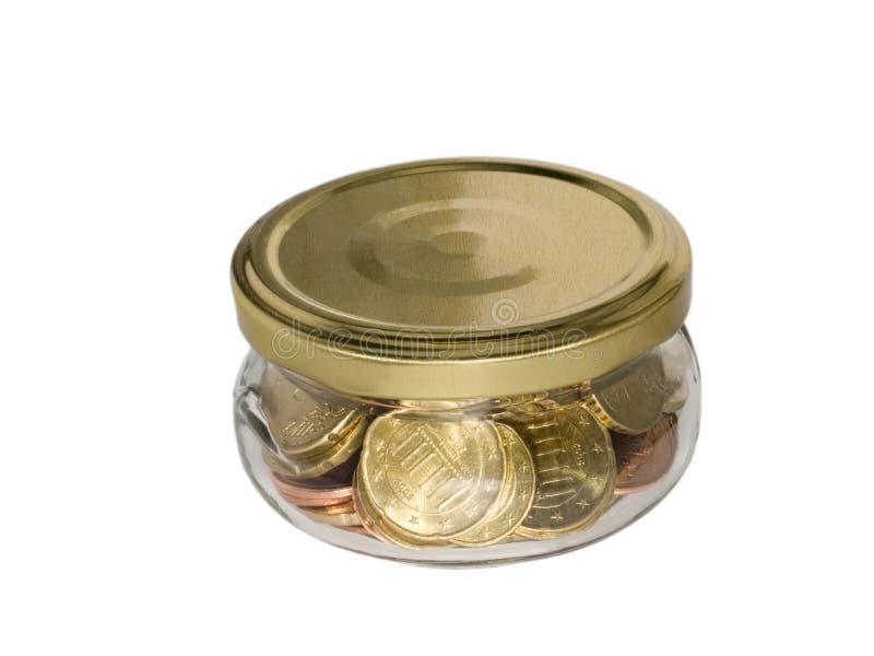 Münzengeld im Glasglas stockbild
