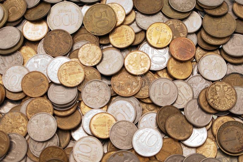 Münzenhintergründe lizenzfreie stockfotografie