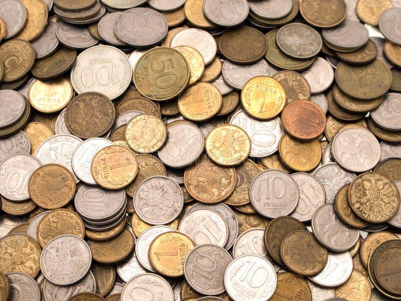 Münzenhintergründe stockfotos