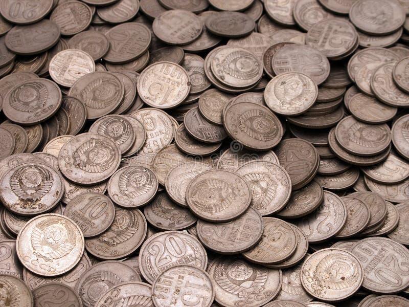 Münzenhintergründe stockfotografie