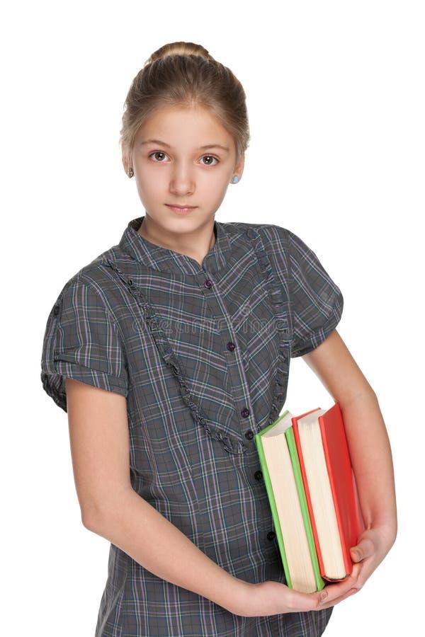Mądre dziewczyna chwytów książki zdjęcia royalty free