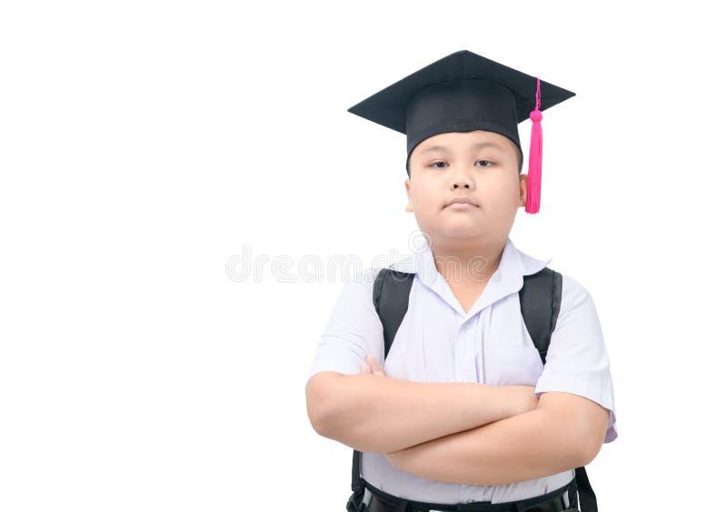 Mądrze azjatykci chłopiec uczeń z magisterską nakrętką odizolowywającą zdjęcia royalty free
