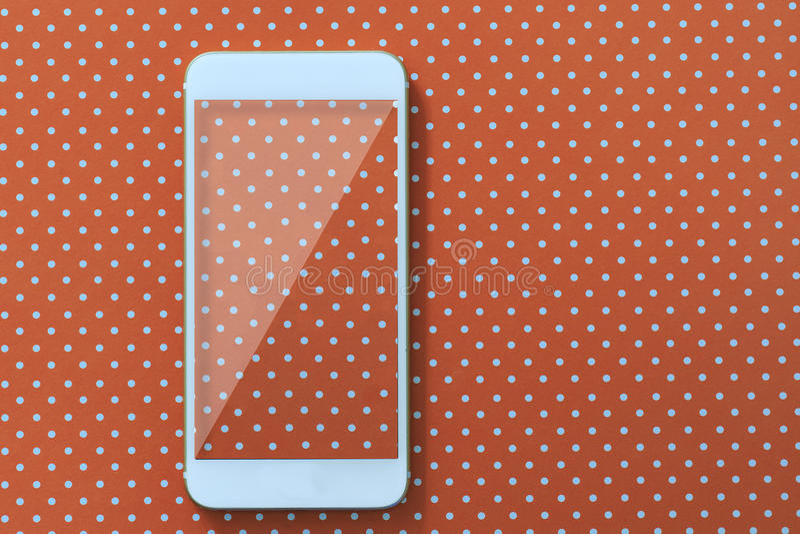 Mądrze telefon fotografia nad nakrywającym pomarańczowym tłem zdjęcia royalty free