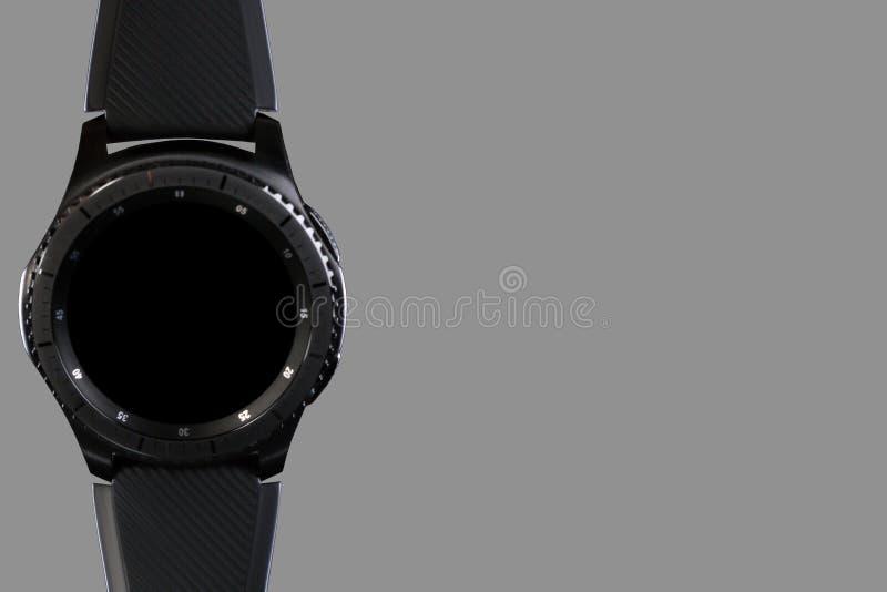 Mądrze zegarek z pustą tarczą na popielatym tle obraz royalty free