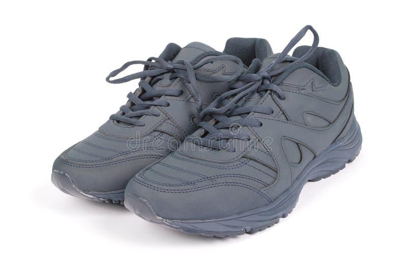Mężczyzn błękitni sneakers fotografia stock