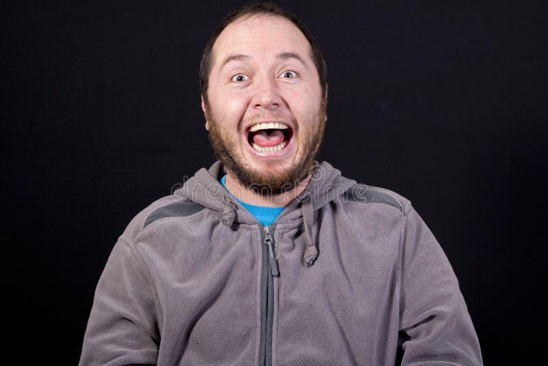 Mężczyzna śmia się out głośnego obrazy stock