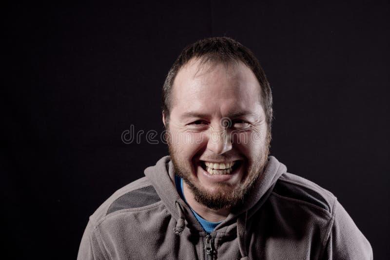Mężczyzna śmia się out głośnego obraz stock