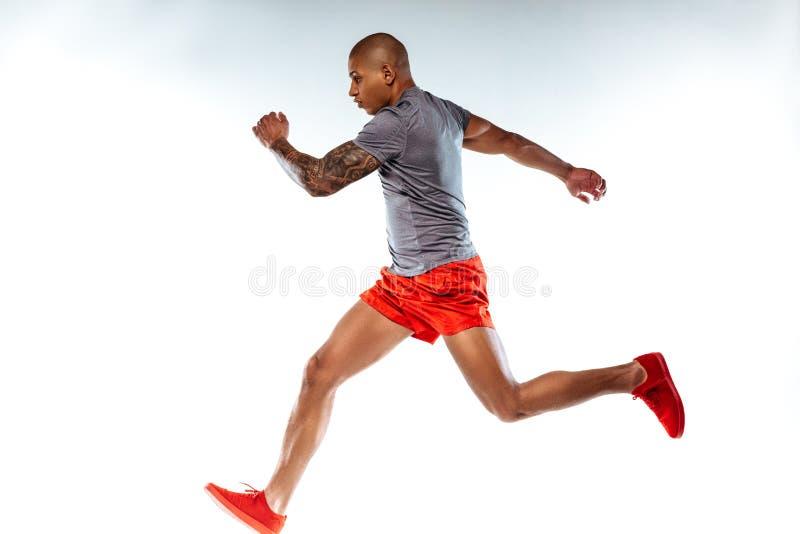 Mężczyzna biega bardzo szybko w bieg kostiumu obraz royalty free