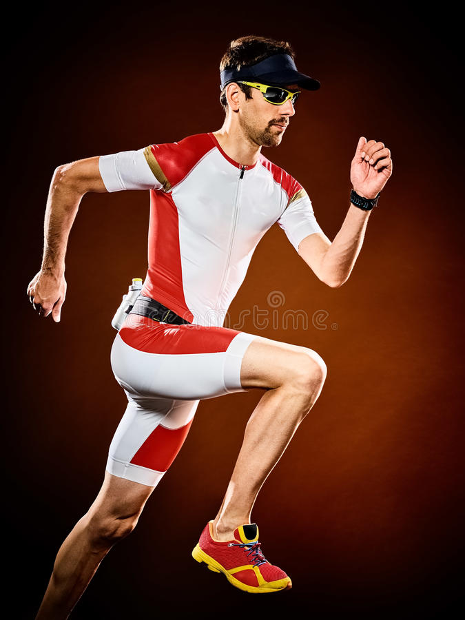 Mężczyzna biegacza triathlon działający ironman odizolowywający zdjęcie stock