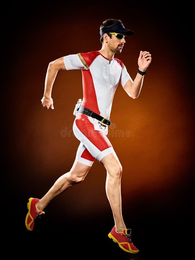 Mężczyzna biegacza triathlon działający ironman odizolowywający zdjęcie royalty free