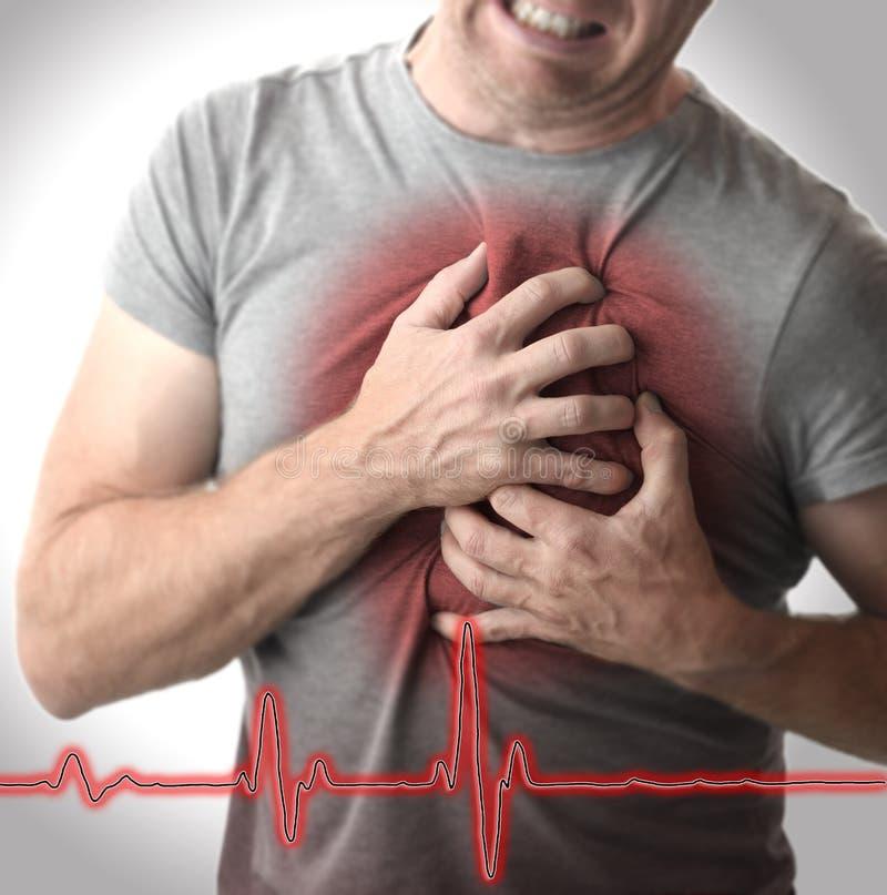 Mężczyzna chwyta klatkę piersiową w bólu obrazy royalty free