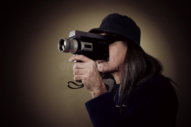 Mężczyzna ekranizacja z rocznika filmu kamerą zdjęcia royalty free