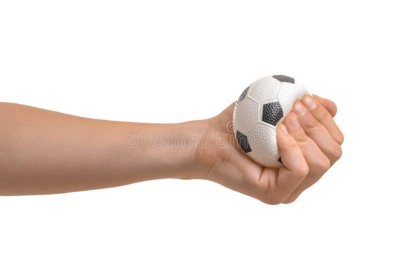 Mężczyzna gniesie stres piłkę na białym tle obrazy royalty free