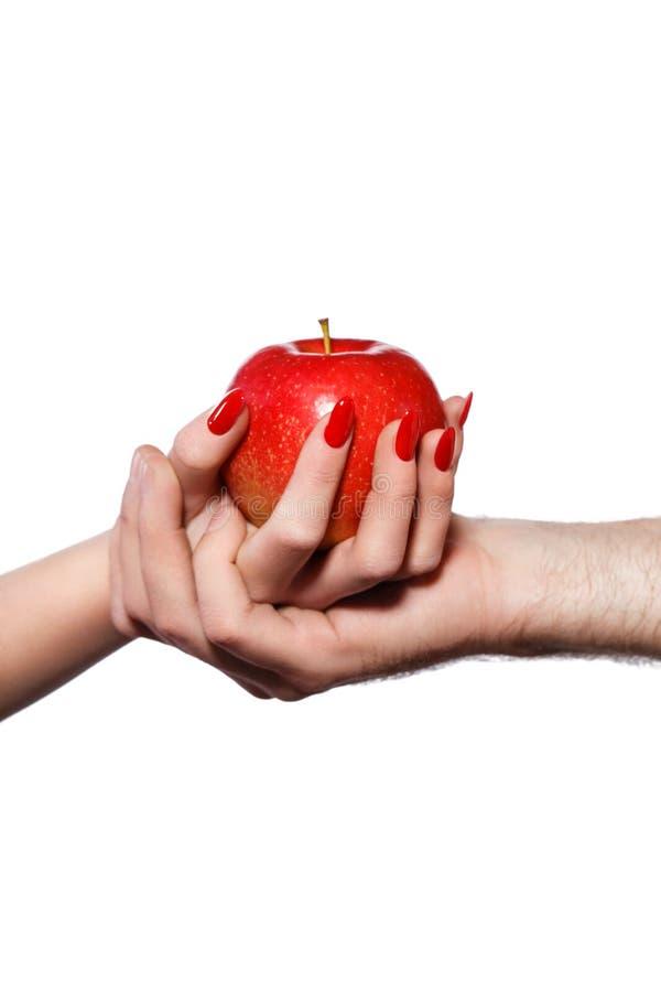 Mężczyzna i kobiety ręki trzyma zakazującą owoc, grzech obrazy stock