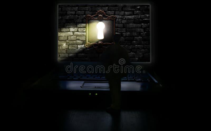 Mężczyzna i komputeru keyhole światło fotografia stock