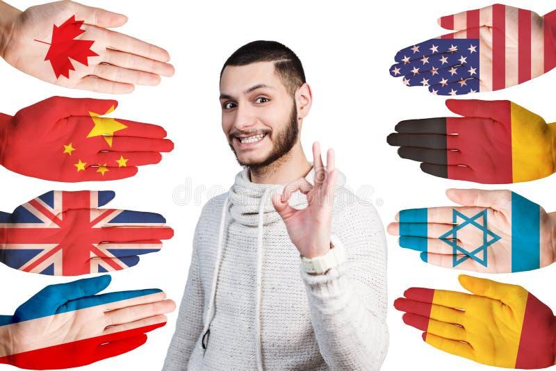 Mężczyzna i wiele ręki z różnymi flaga zdjęcia royalty free