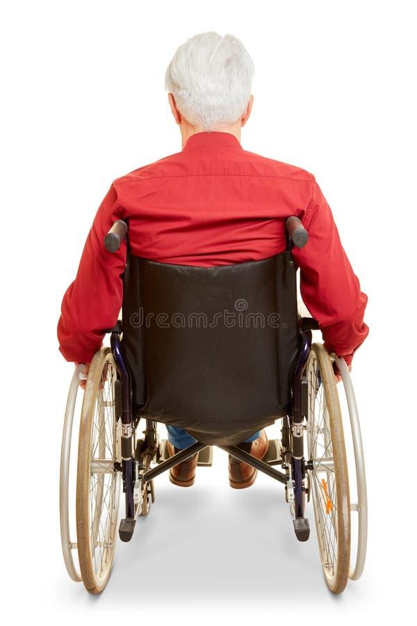 Mężczyzna jako wózka inwalidzkiego użytkownik od za zdjęcia royalty free