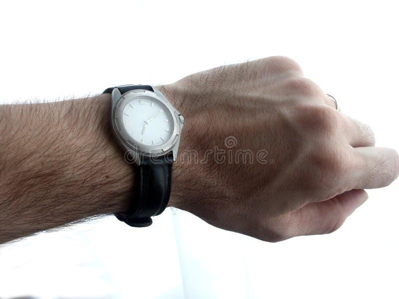 mężczyzna jego przyglądający zegarek obraz royalty free