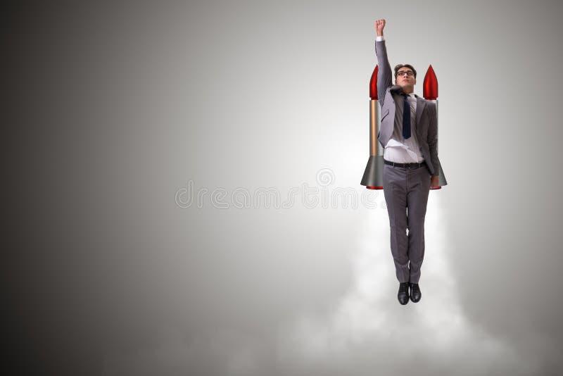 Mężczyzna latanie z rakietą w biznesowym pojęciu zdjęcie stock