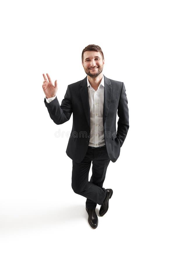 Mężczyzna macha jego w formalnej odzieży ręka obraz royalty free