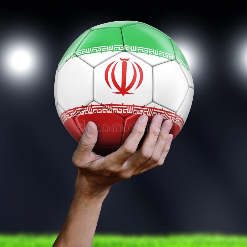 Mężczyzna mienia piłki nożnej piłka z irańczyk flaga obraz royalty free
