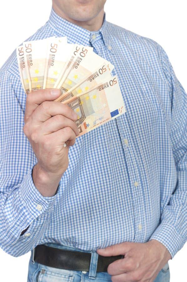 Mężczyzna mienia pieniądze w ręce obraz royalty free