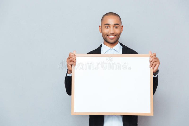 Mężczyzna mienia whiteboard zdjęcie royalty free