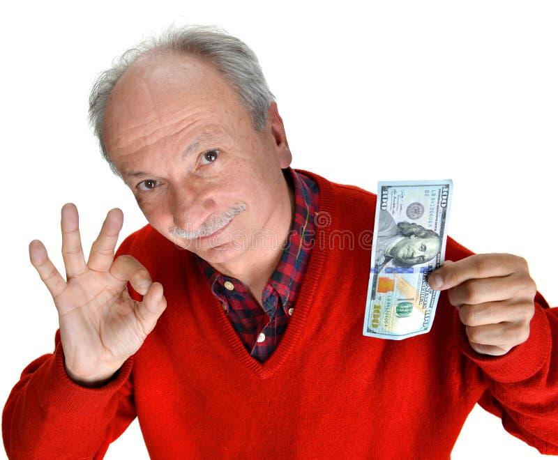 Mężczyzna mienie z przyjemności sto dolarowym rachunkiem obraz royalty free