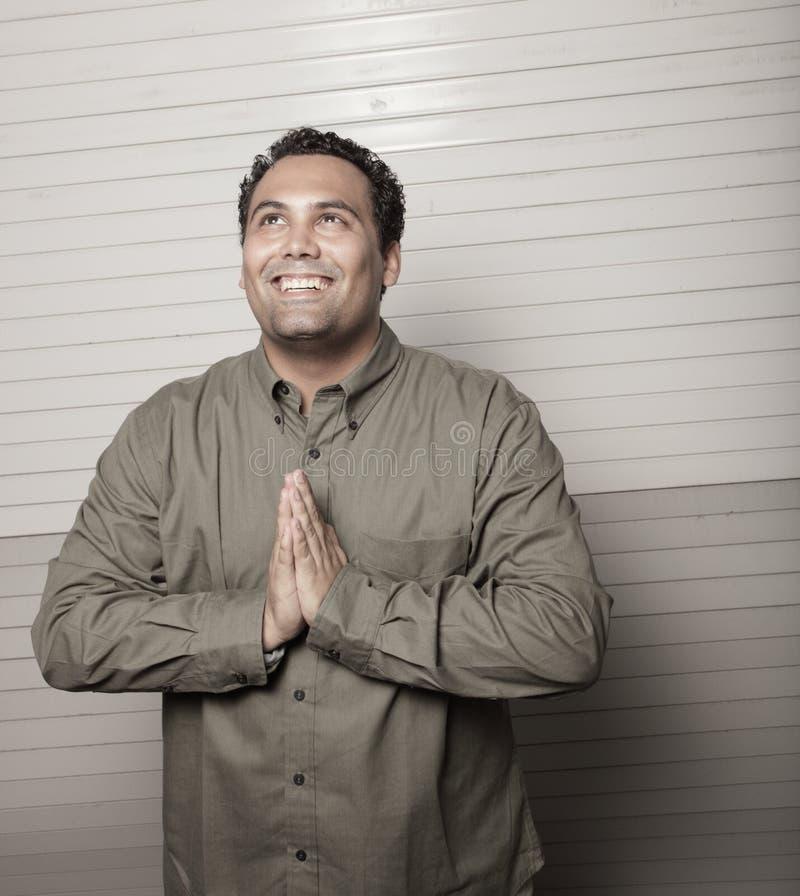 mężczyzna modlenia ja target724_0_ zdjęcie royalty free
