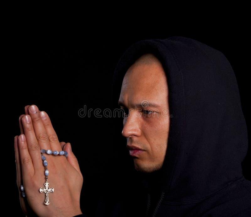 mężczyzna modlenia potomstwa zdjęcie stock