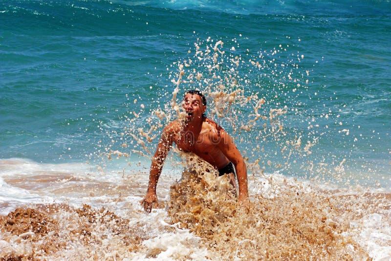 Mężczyzna na plaży obraz royalty free