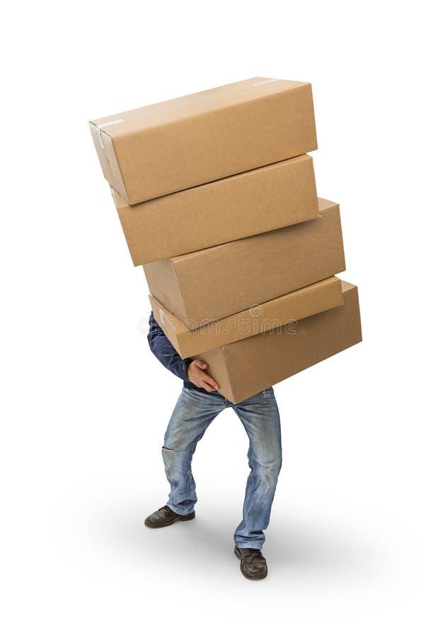 Mężczyzna niesie ciężkich pudełka zdjęcie stock