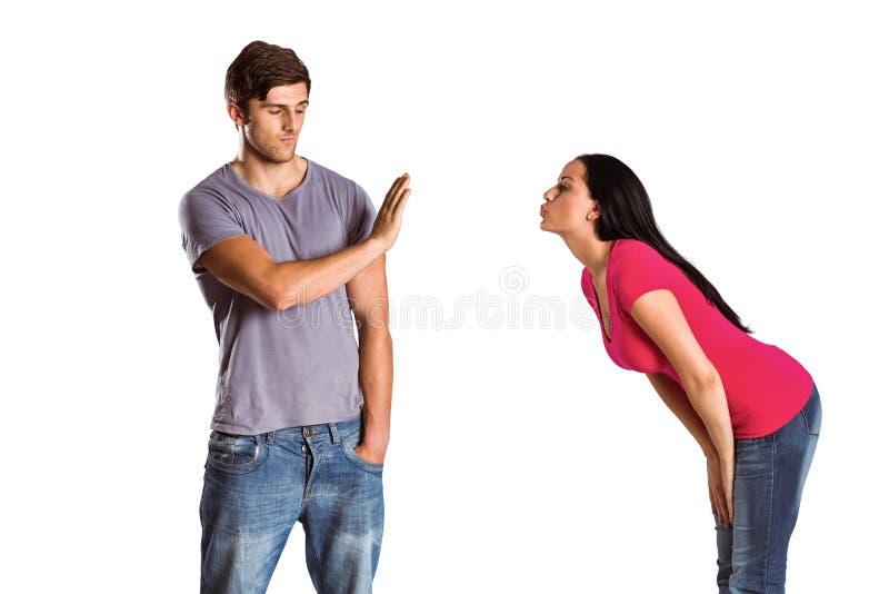 Mężczyzna odmawia buziaka jego dziewczyna obrazy stock