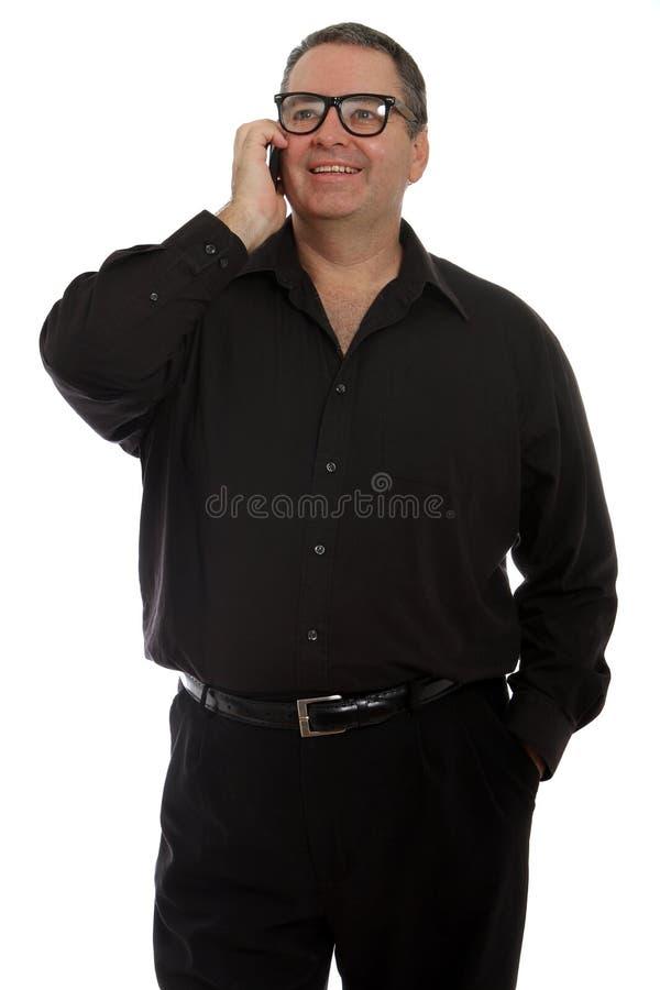 Mężczyzna opowiada na telefonie fotografia stock
