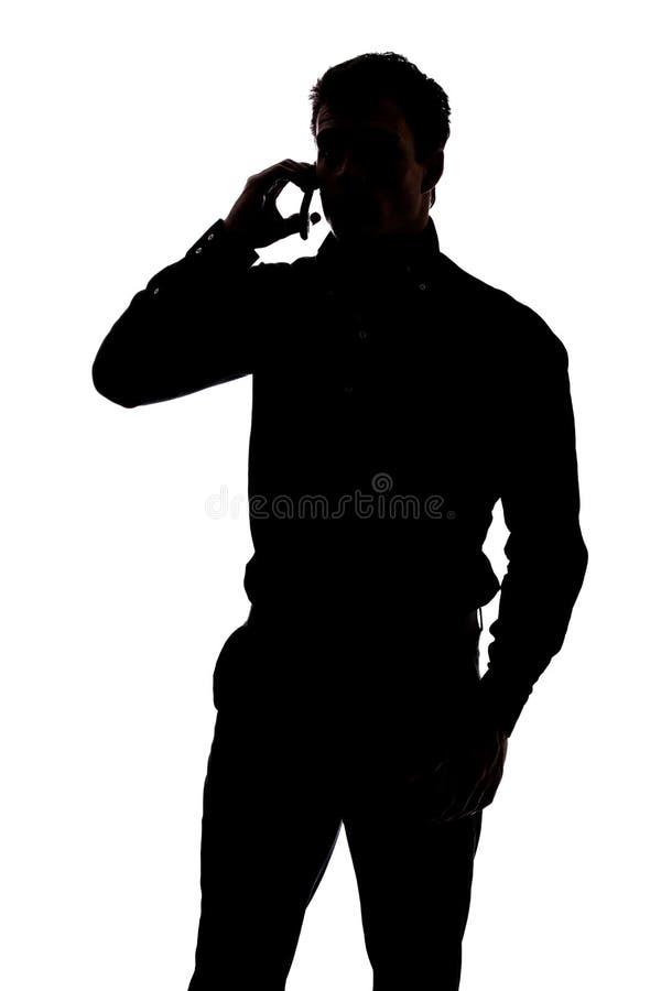 Mężczyzna opowiada na telefonie komórkowym zdjęcia royalty free